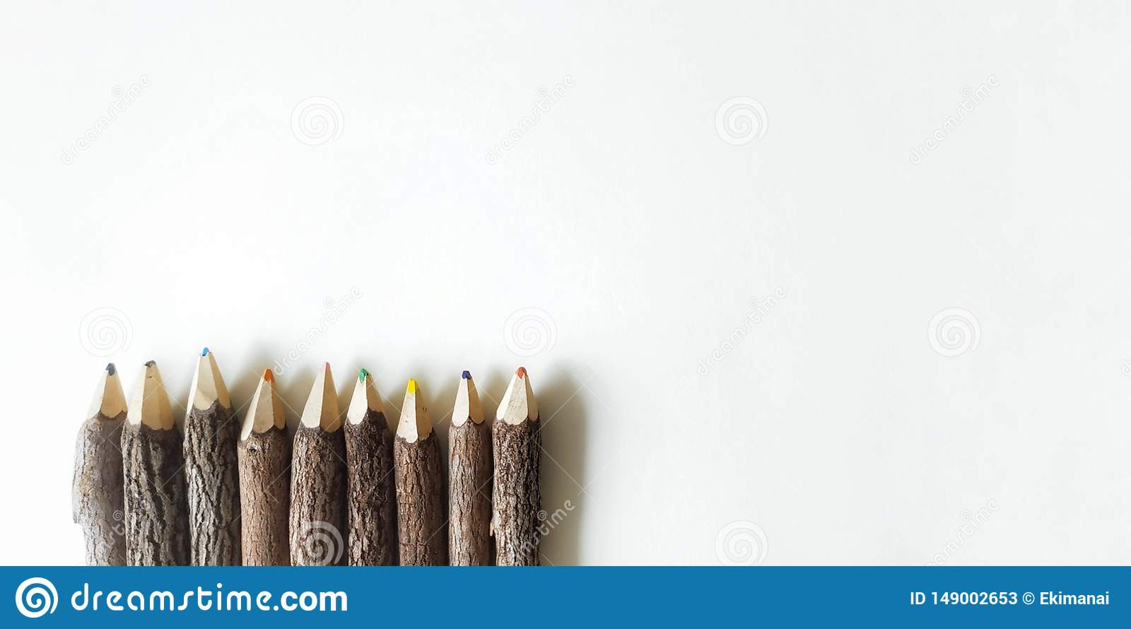 color wooden pencils on white background
