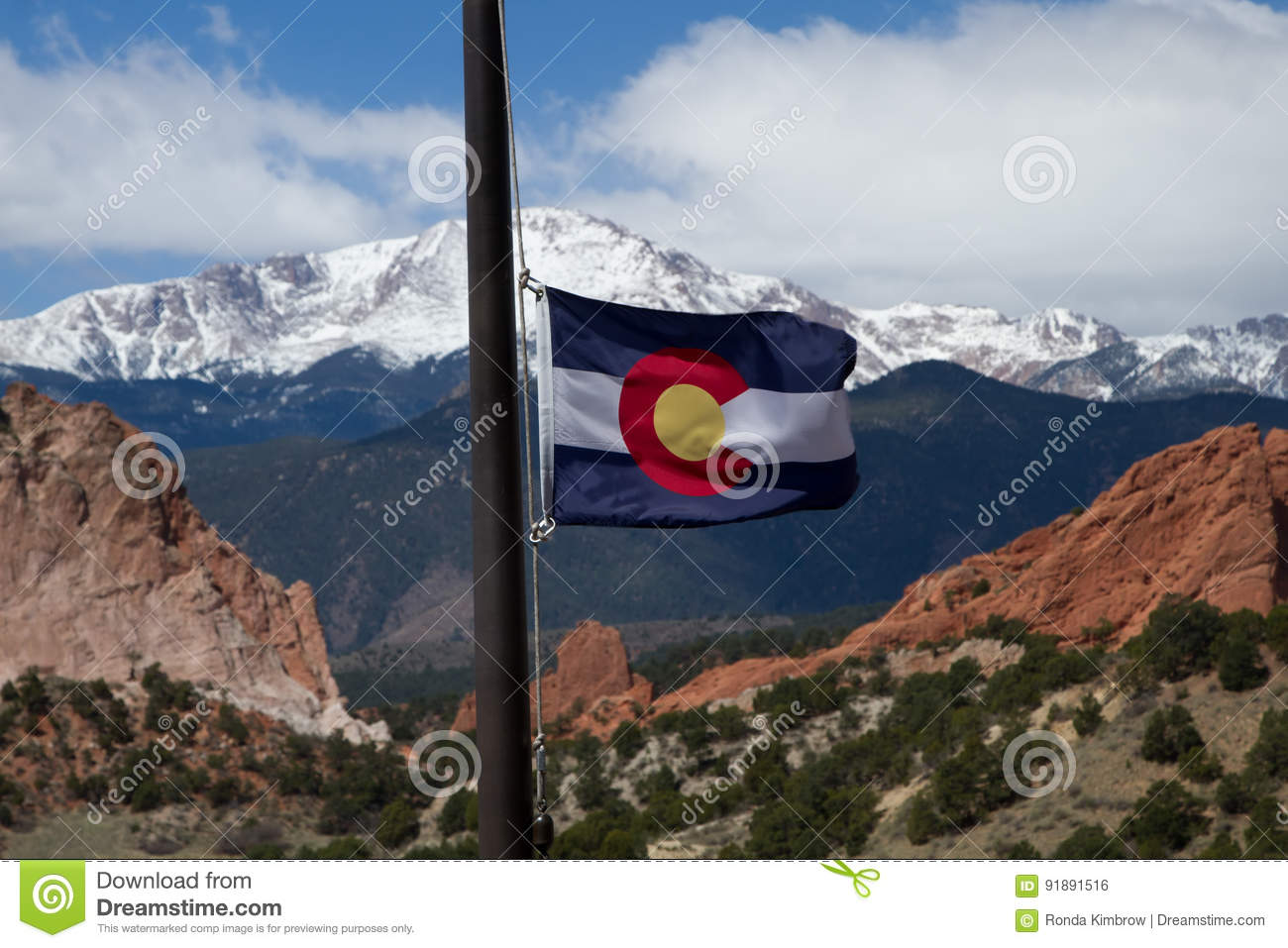 Colorado State Flag with Pikes Peak and Garden of the Gods in th