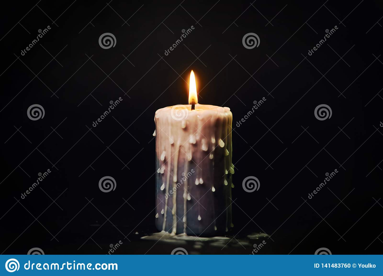 Colored Candle With Drips Of Wax Burns In The Dark Stock ...