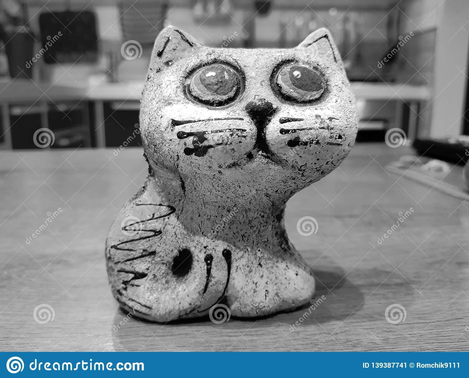 Colored ceramic cat with big eyes