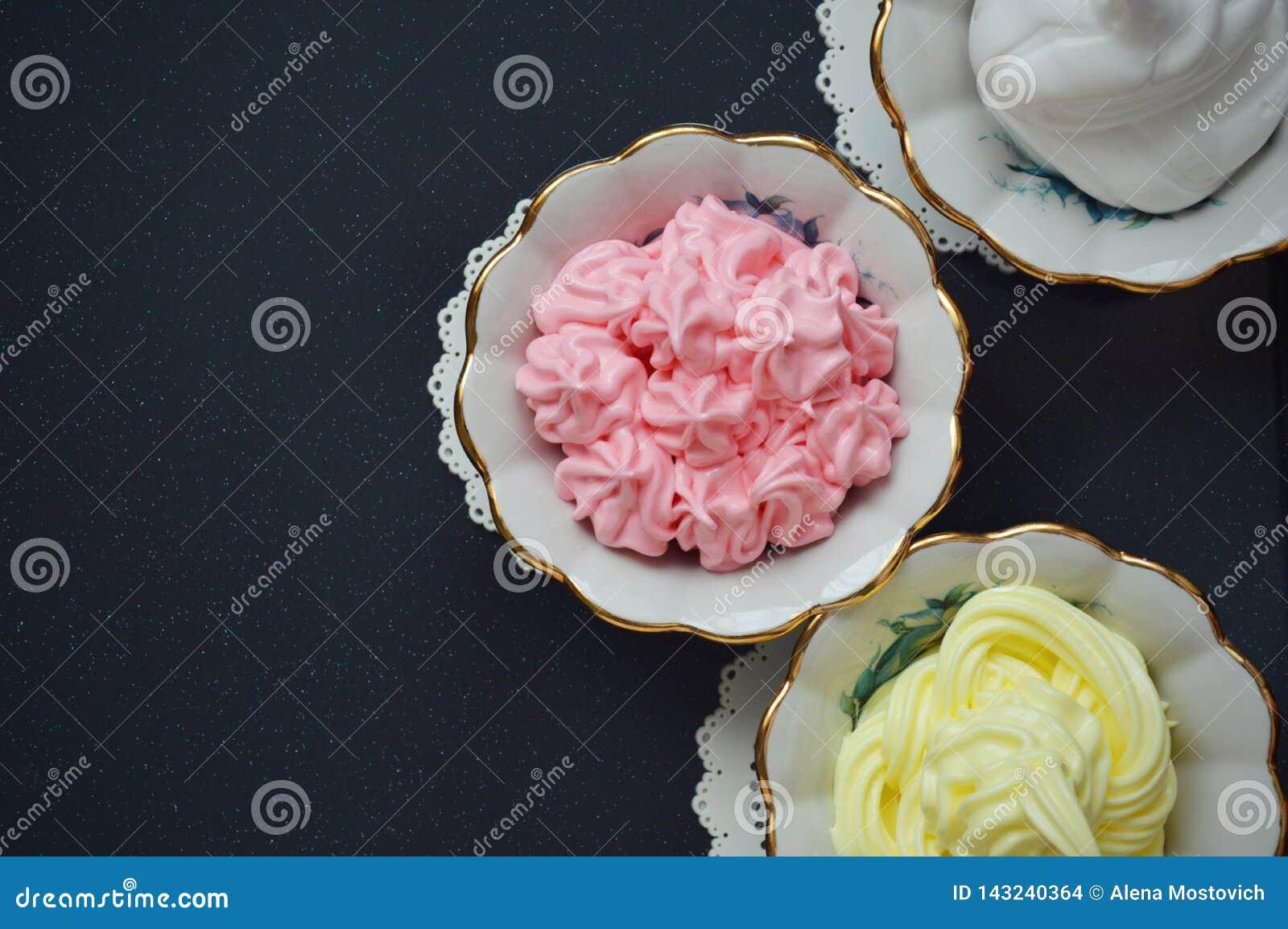 Colored creamy desserts in kremanki