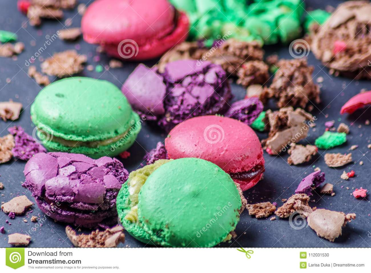 Colored Crumbed Macaroons on a black background, closeup.