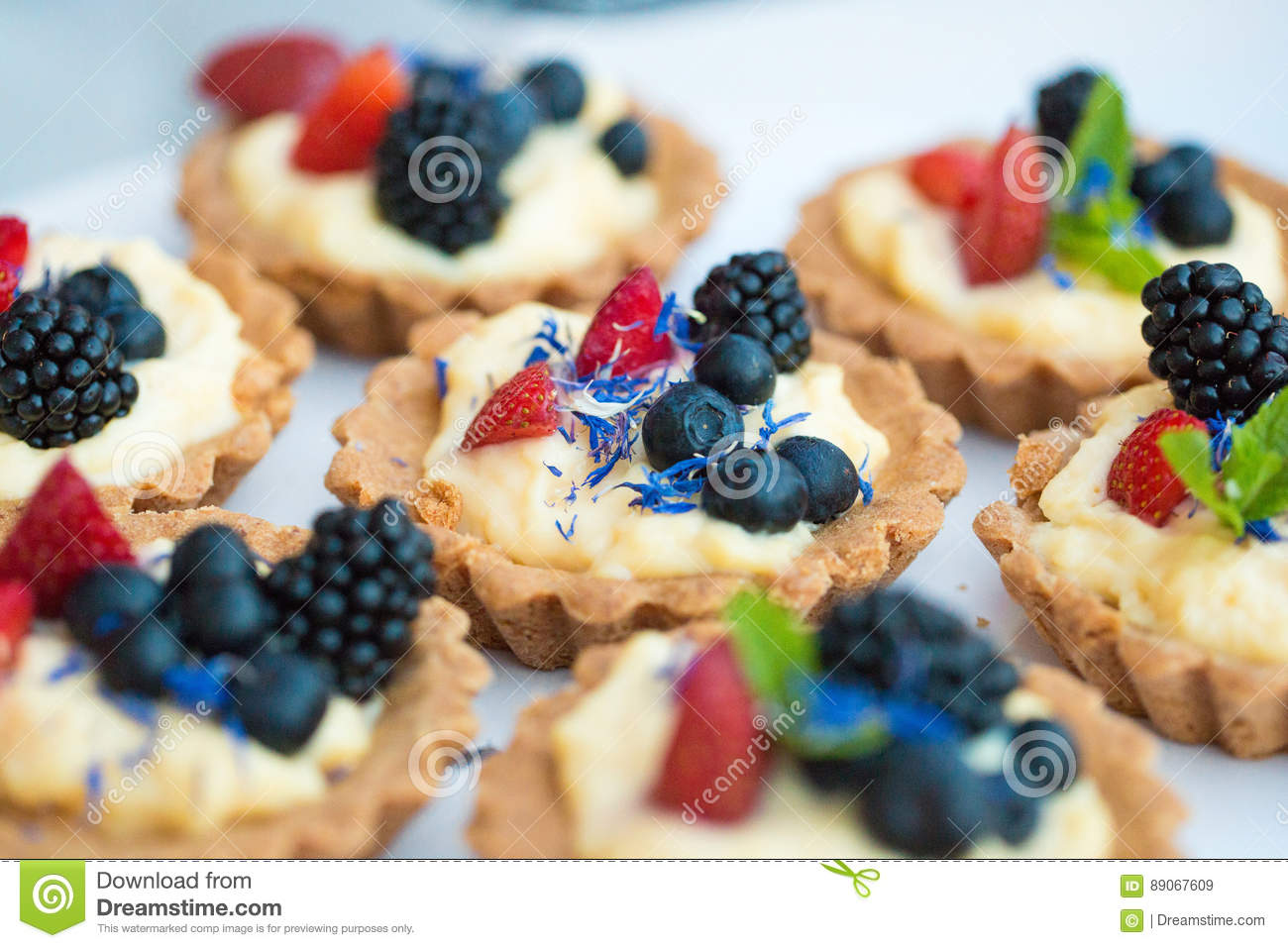 Colored desserts provided in glass jars