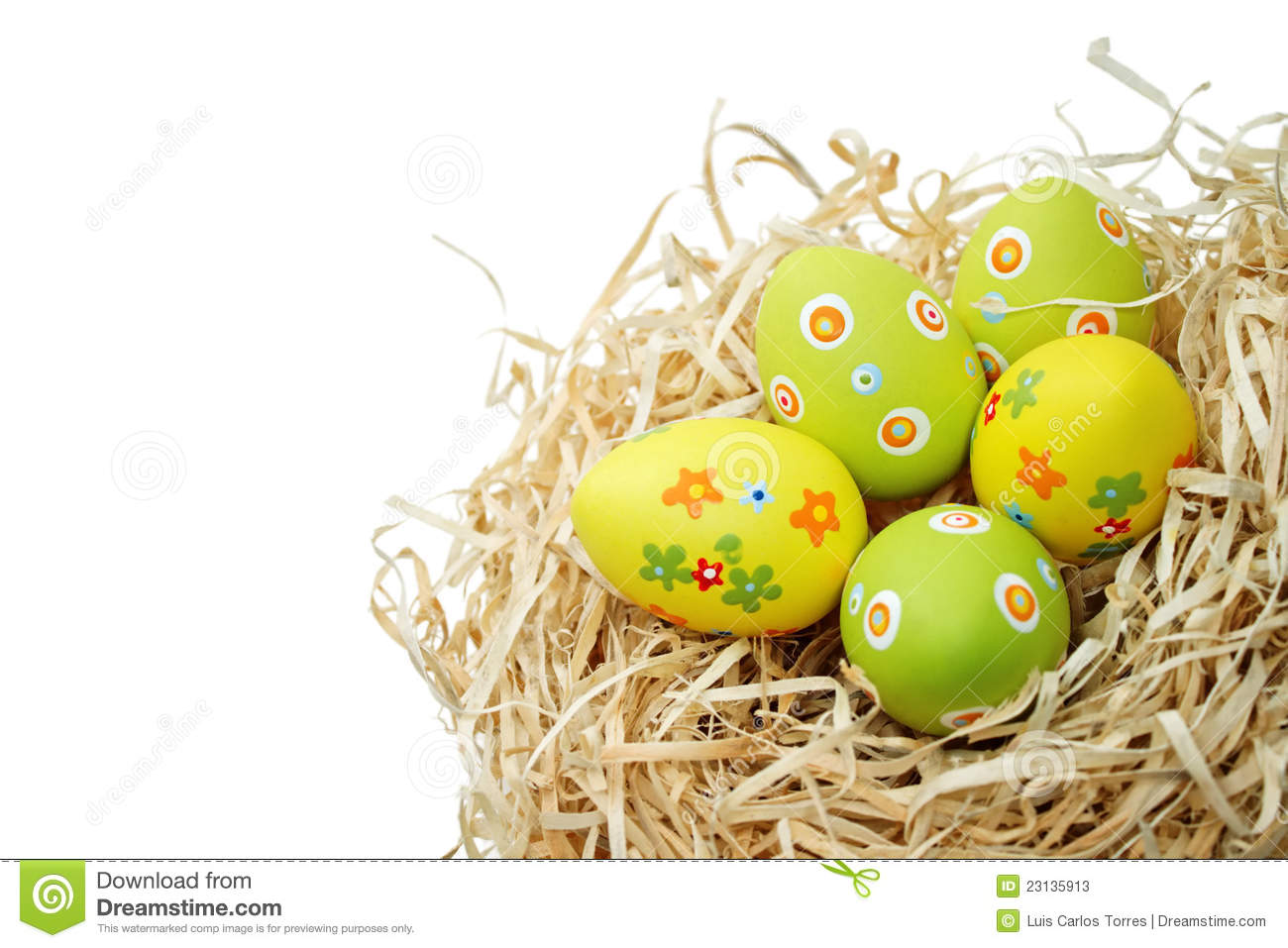 Colored Easter eggs into a nest