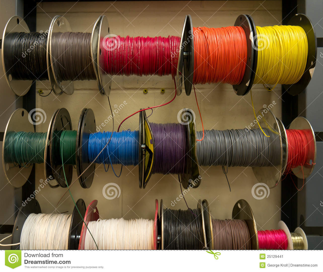 Electrical Wire Spool : Colored electrical wires on spools rack stock image