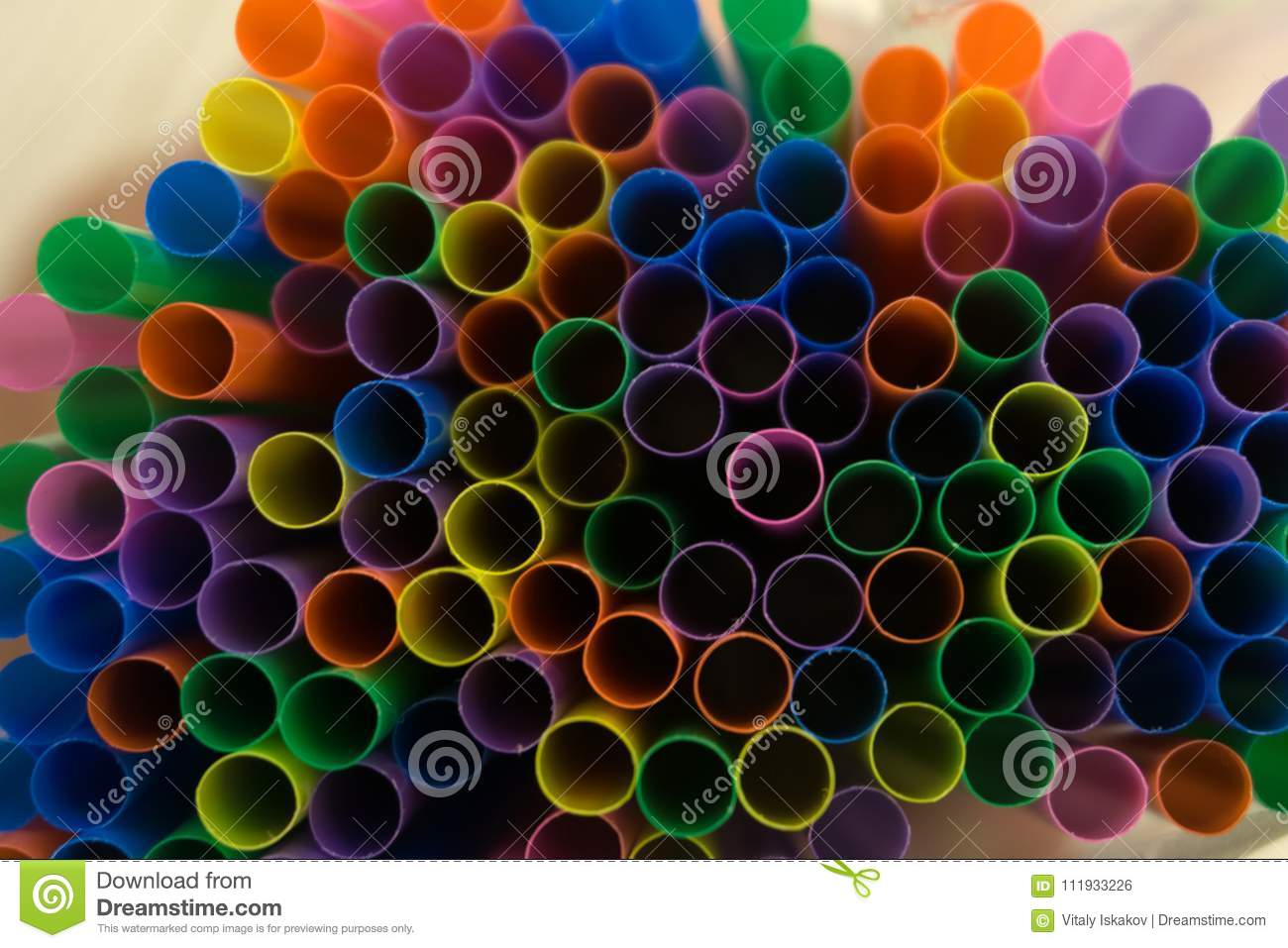 Colored Flexible Straws In The Glass Isolated On White