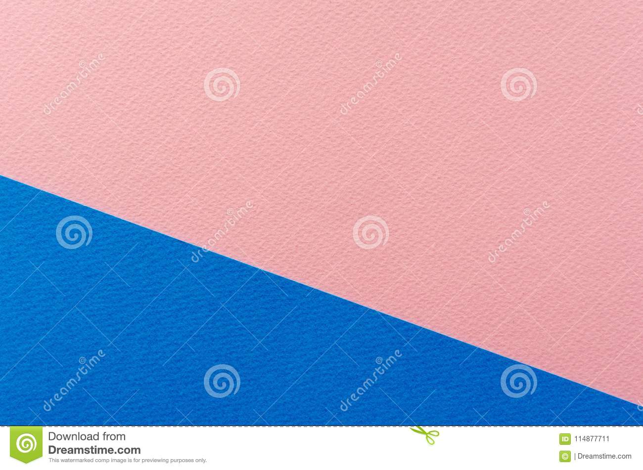 Colored geometric blue and pink paper texture background.