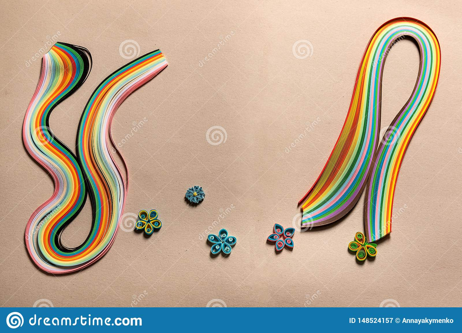 Colored, multi-colored paper special strips for quilling on cardboard for hobbies , figures for decoration