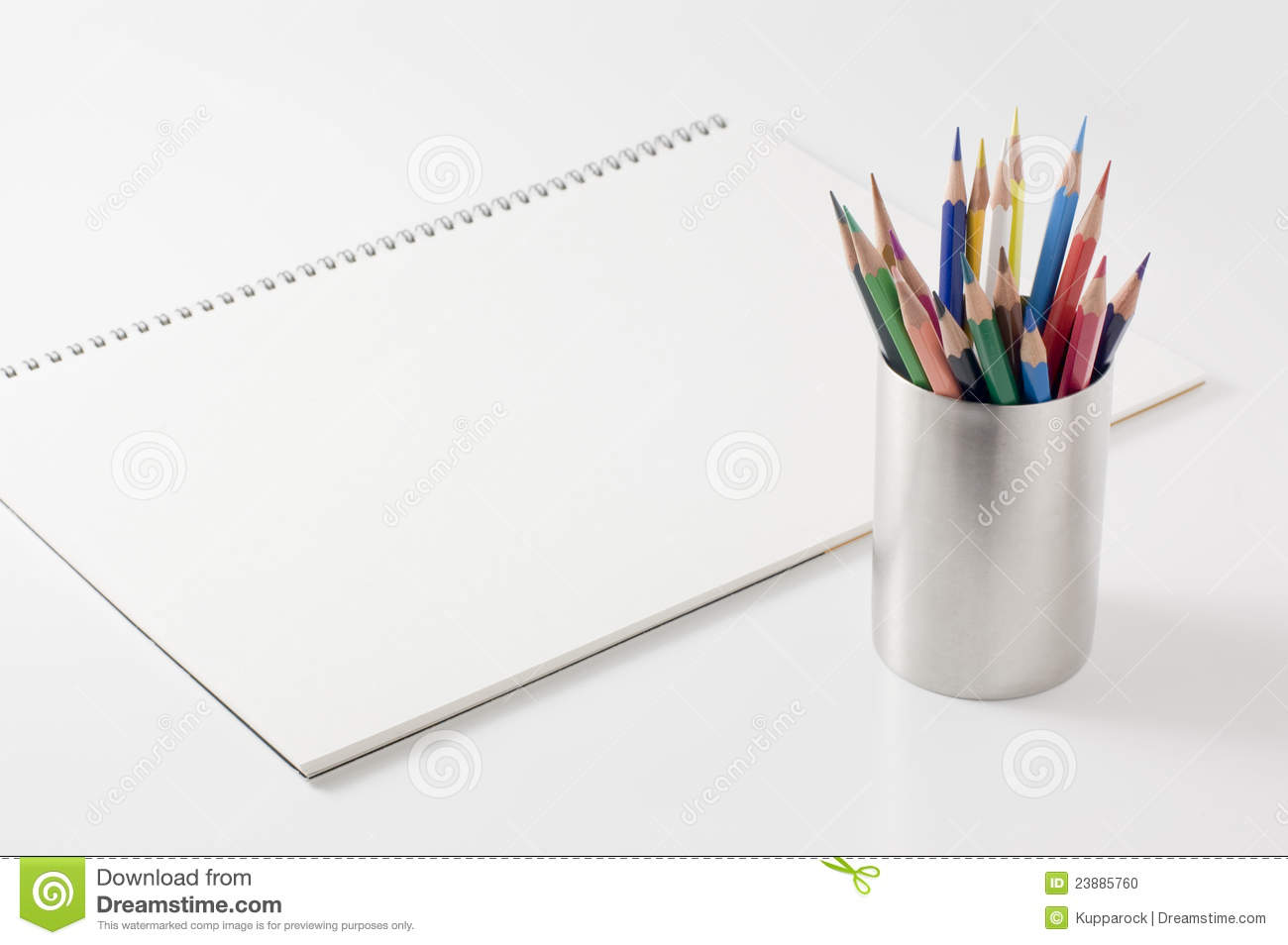 Blank sketchbook and pencils