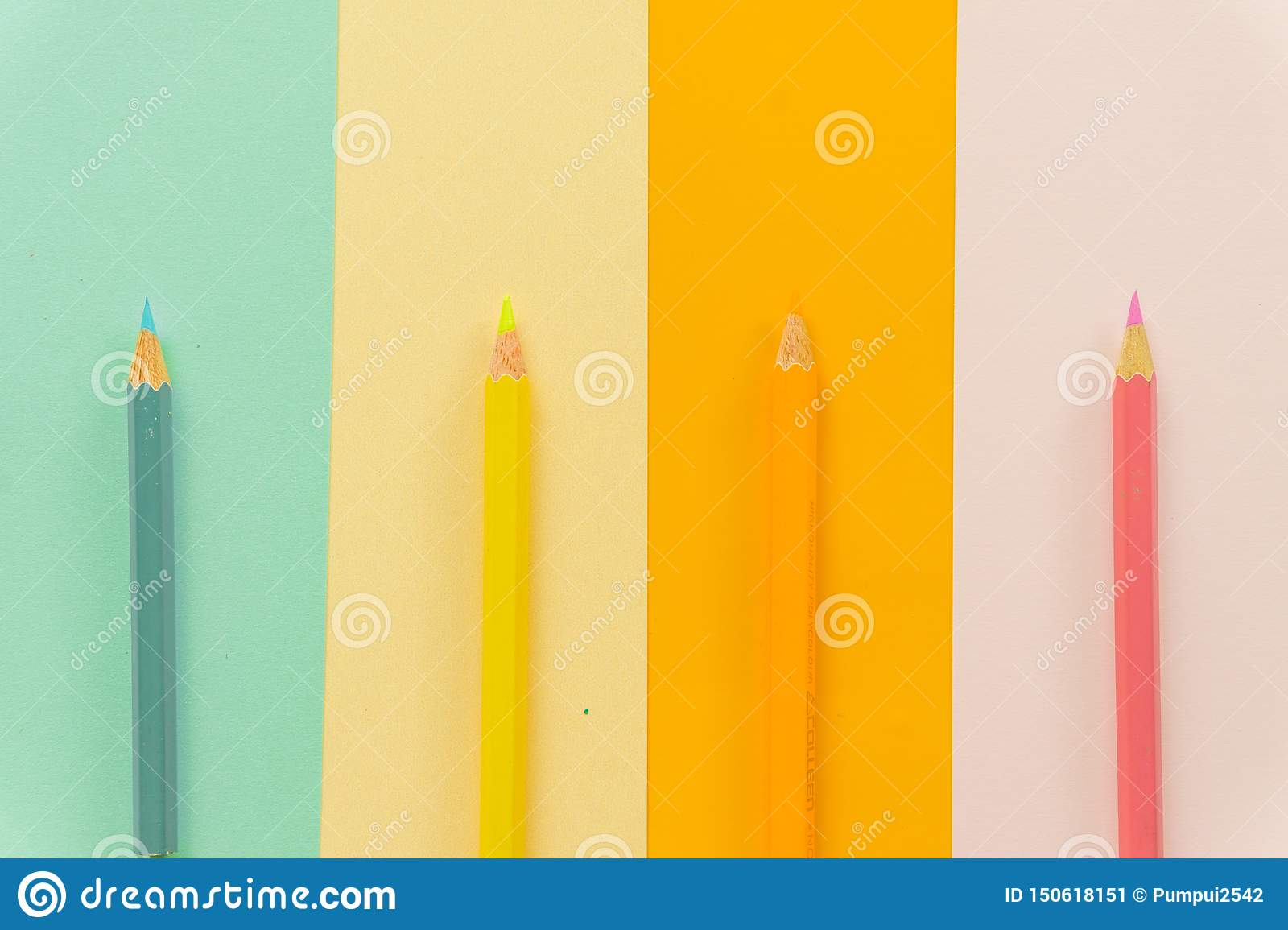 Colored pencils Blue, yellow, orange and pink on Blue, yellow, orange and pink background.
