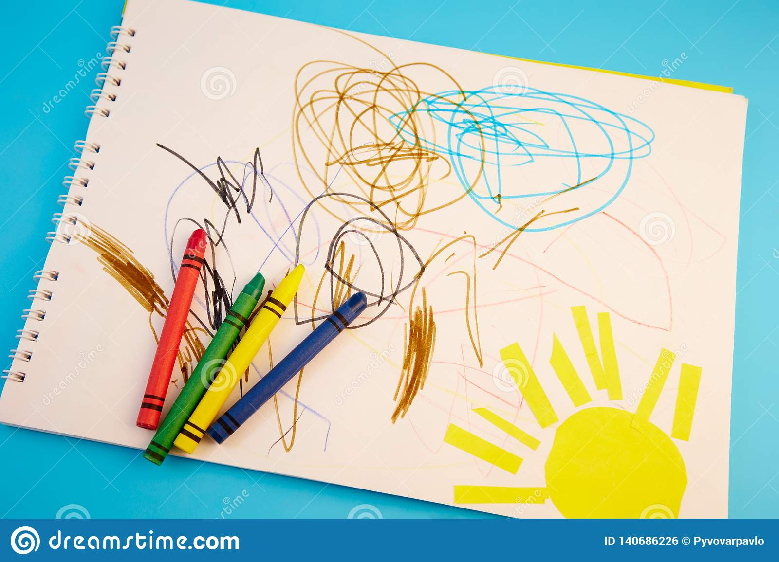 colored pencils and children`s drawings