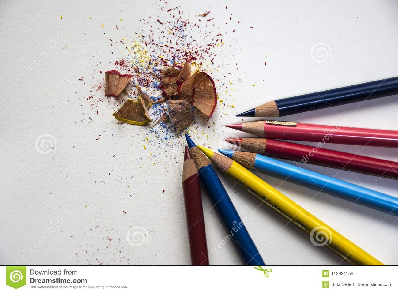 Colored pencils with colorful pencil shavings