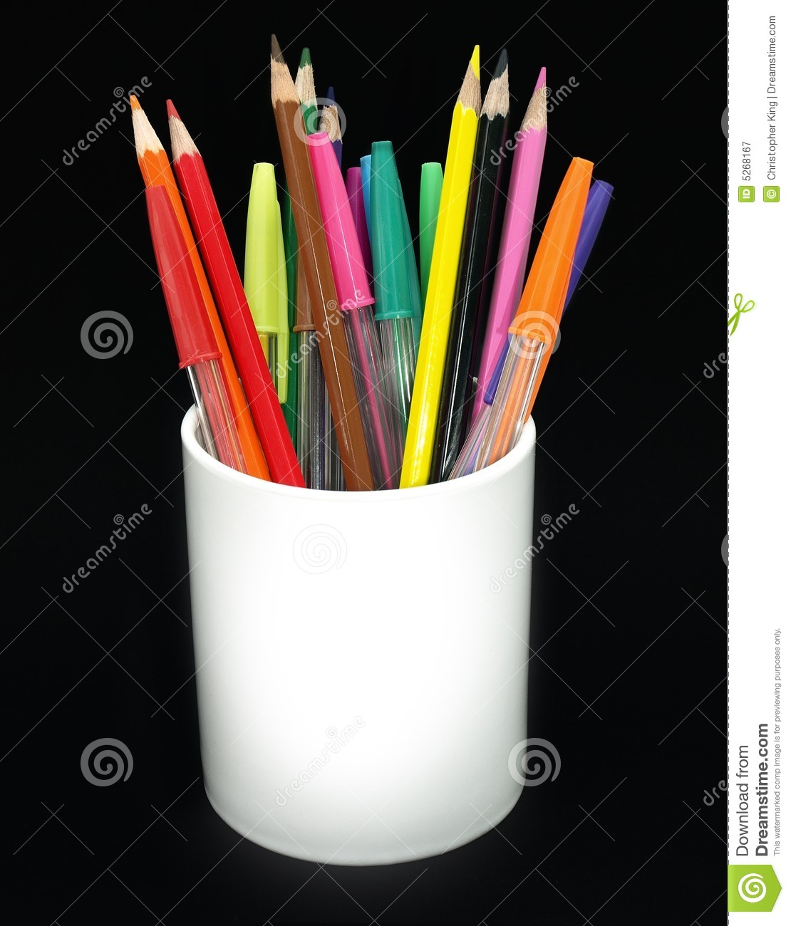 colored pencils and pens in a jar royalty free stock