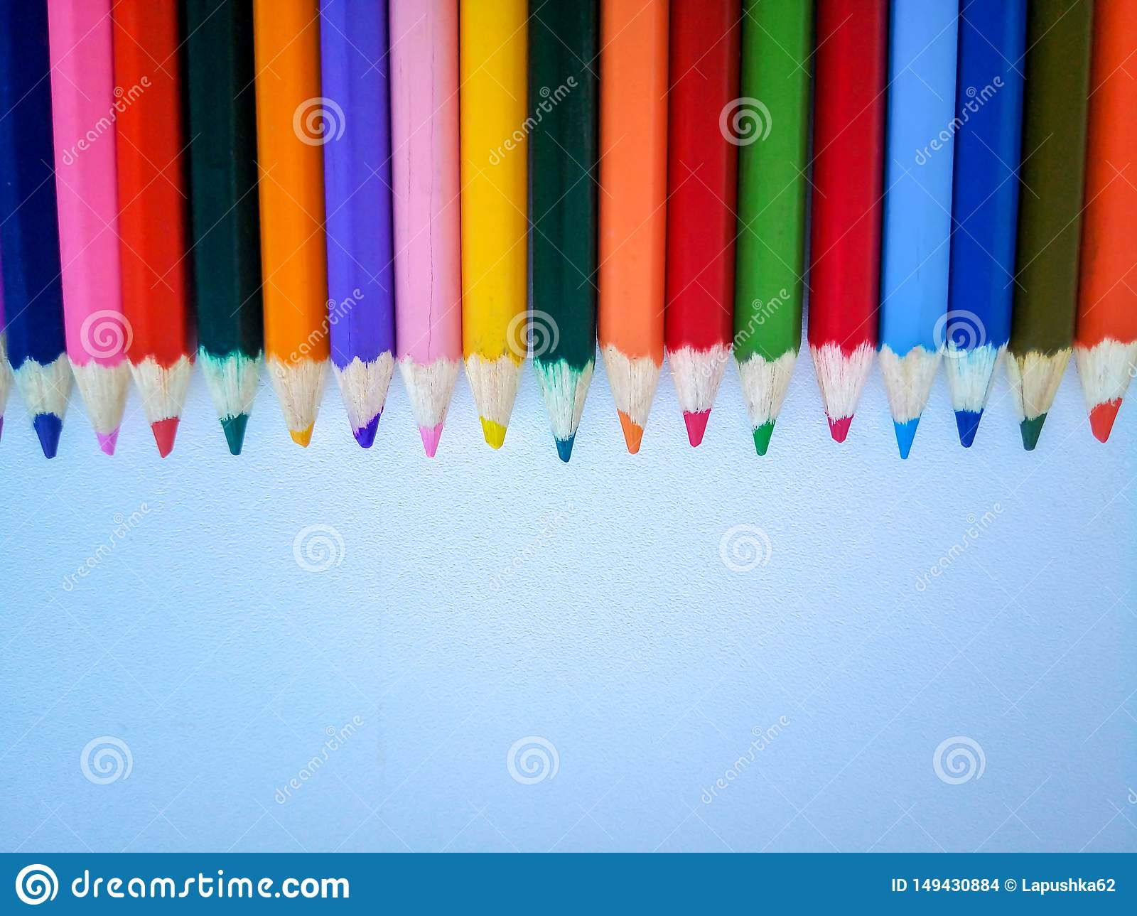 Colored pencils at the top on a white background