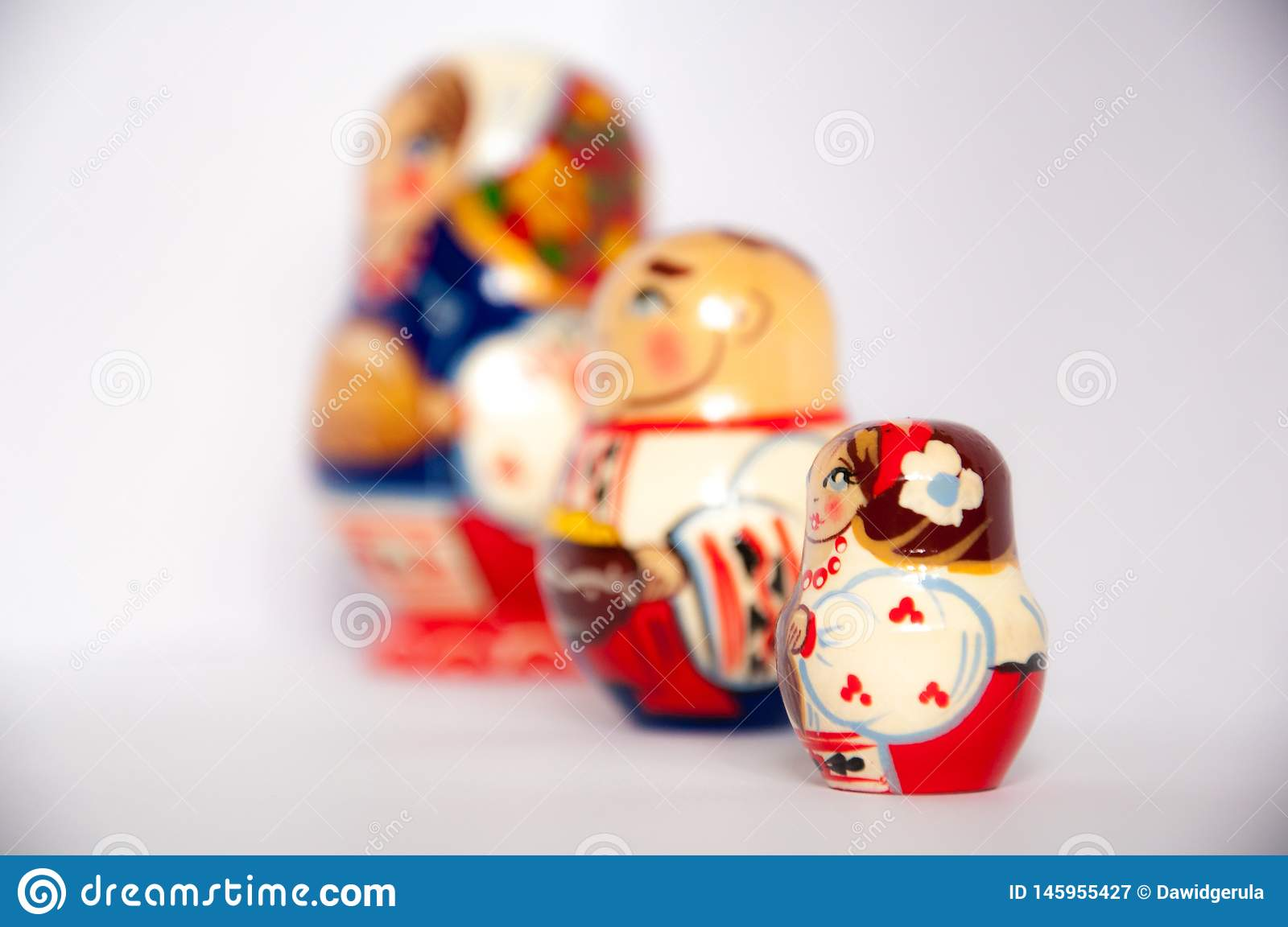 Colored russian matrioshka dolls on grey isolated background