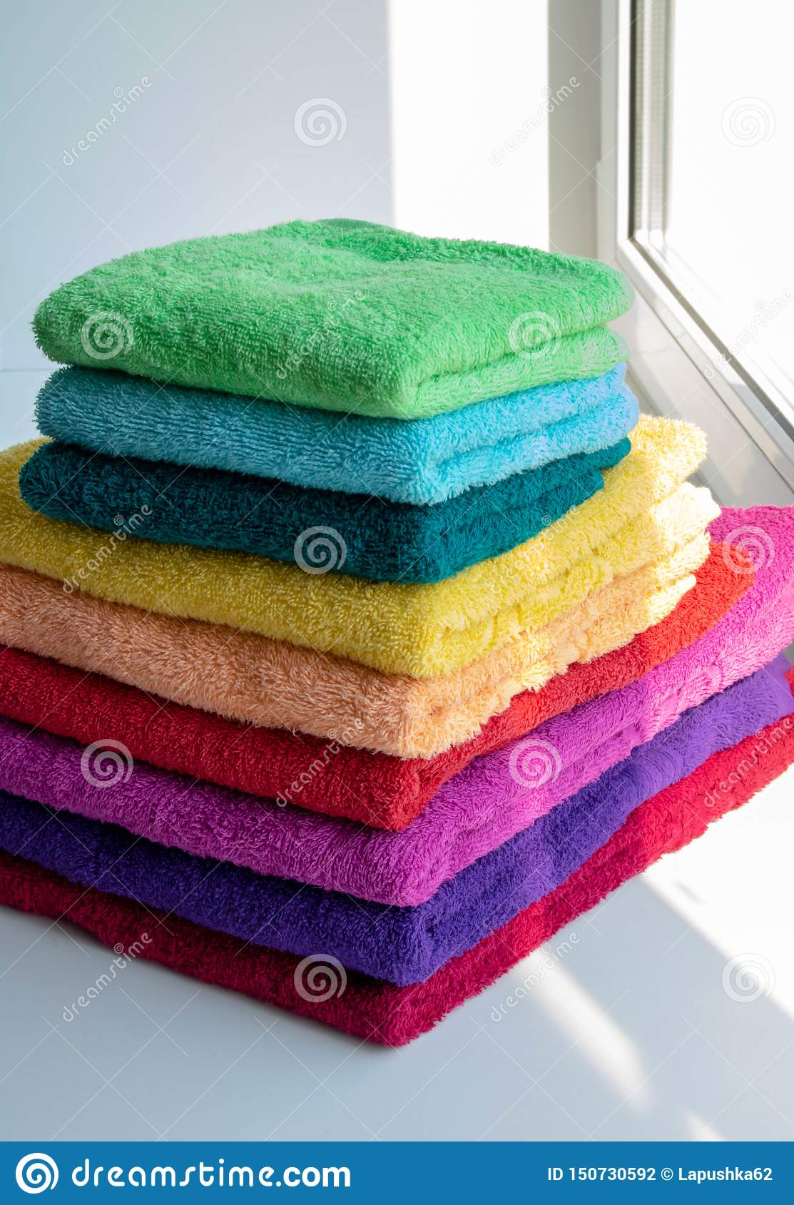 Colored towels on a sunny window
