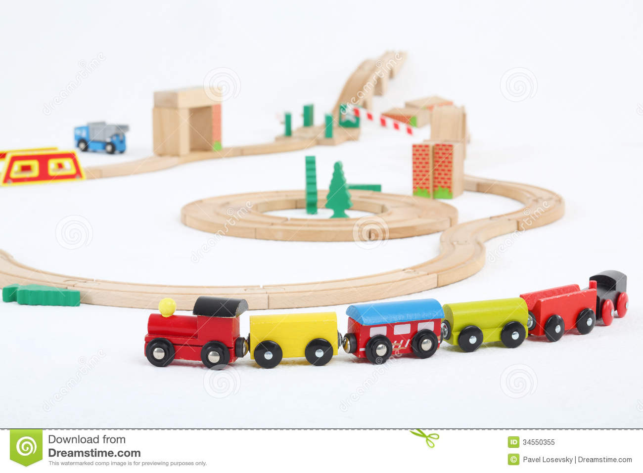 Colored train with cars and wooden toy railway on white background ...