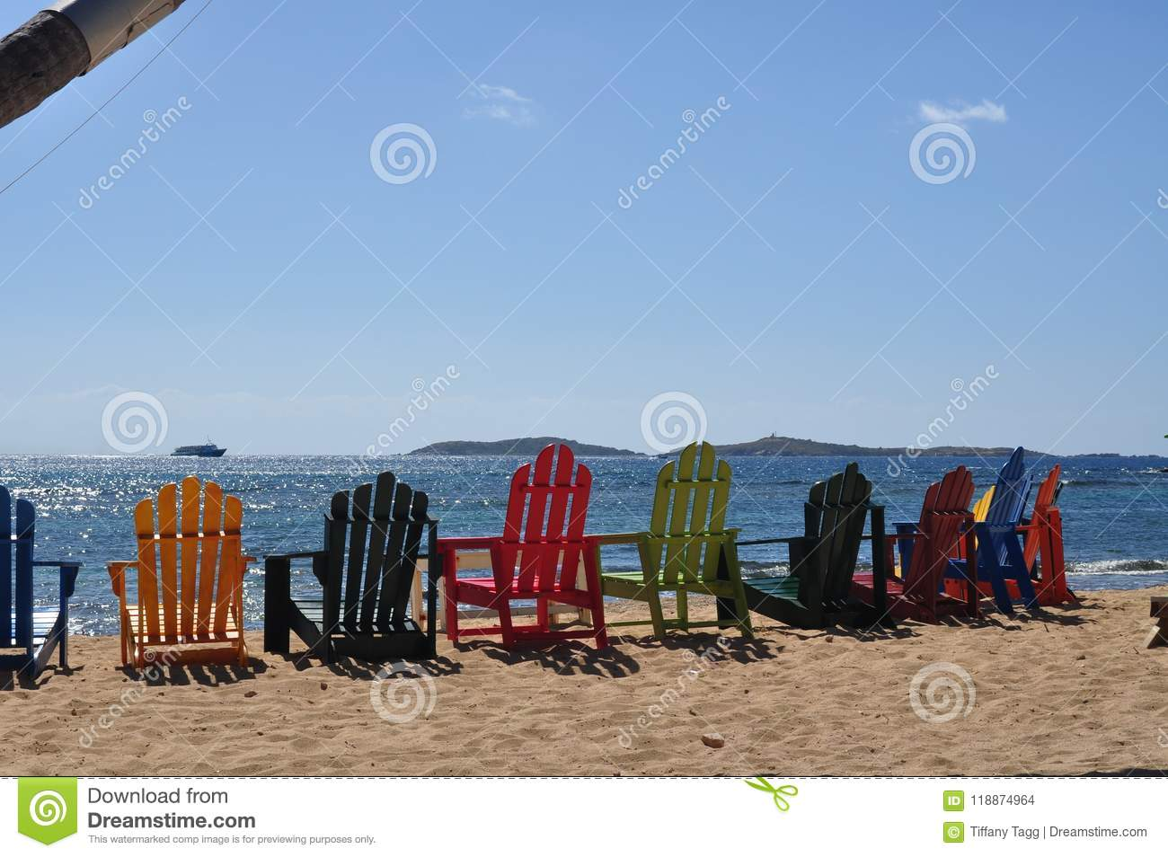 Colorful Adirondack Chairs On A Sandy Beach Stock Photo ...