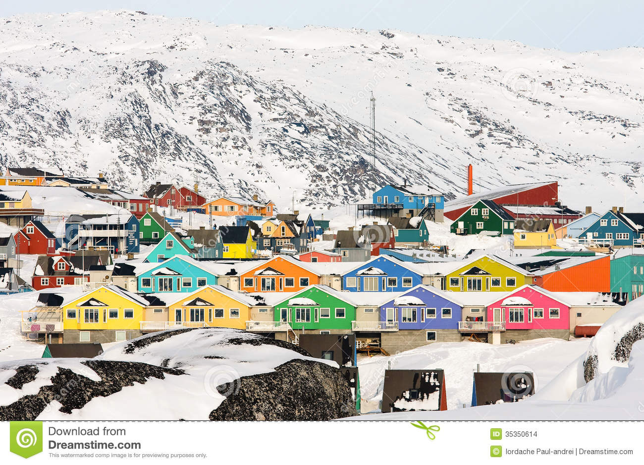 Houses painted in vivid colors make the arctic settlement seem joyful.