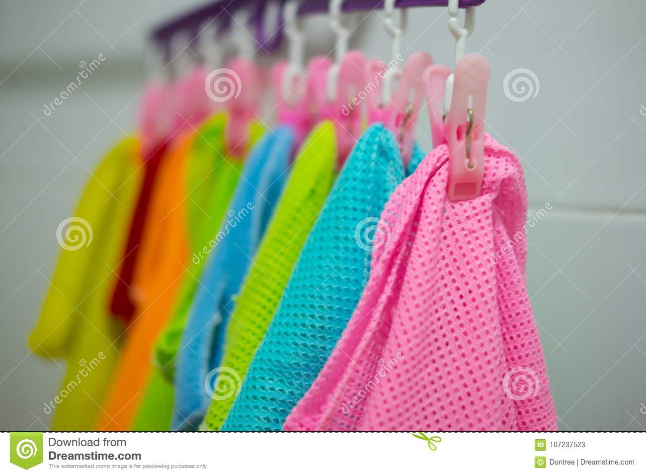 6dfb21a5d Colorful Baby Kids Clothes Hanging On Clothesline Stock Image ...