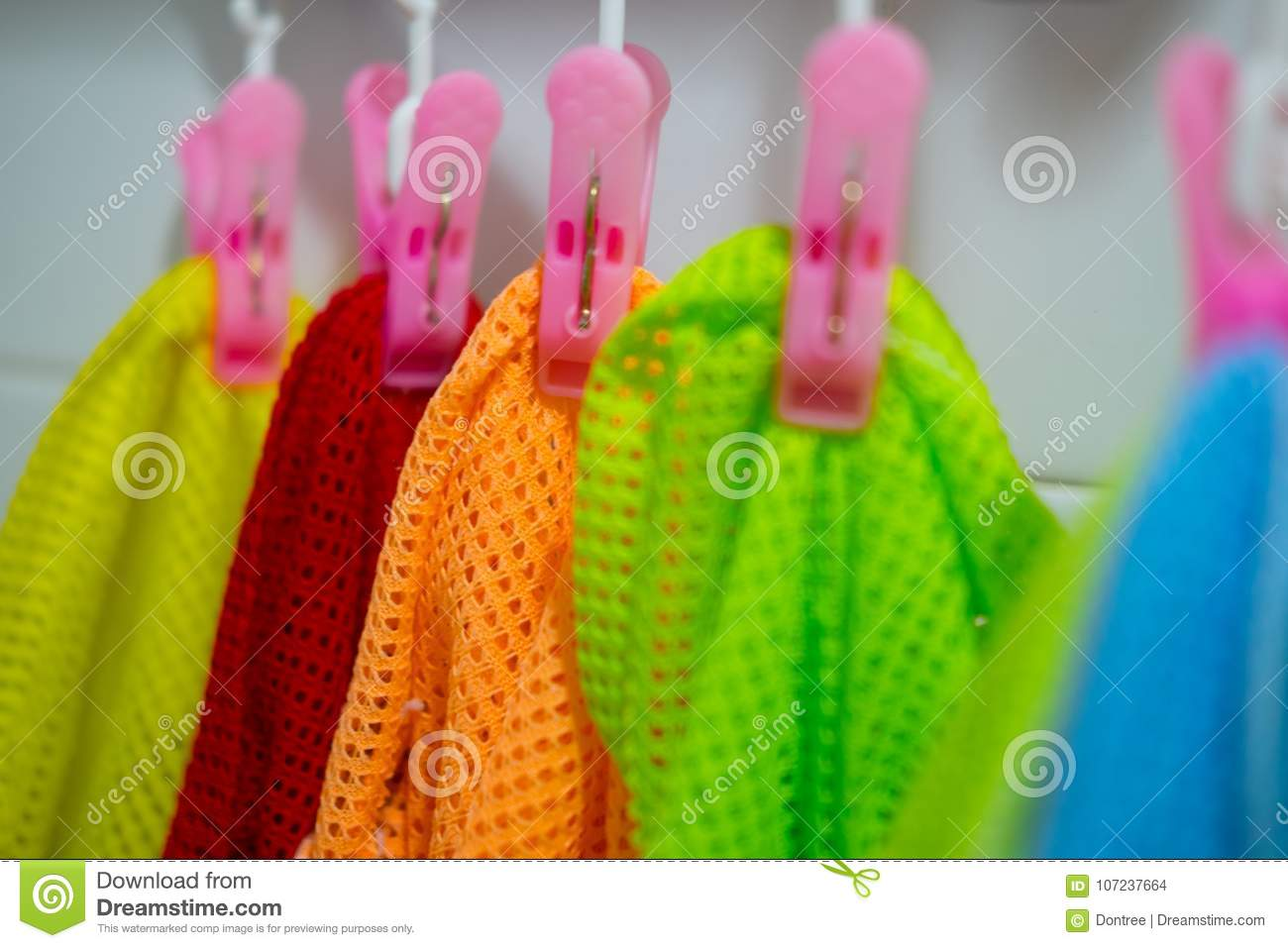 e0f07adc9 Colorful Baby Kids Clothes Hanging On Clothesline Stock Photo ...