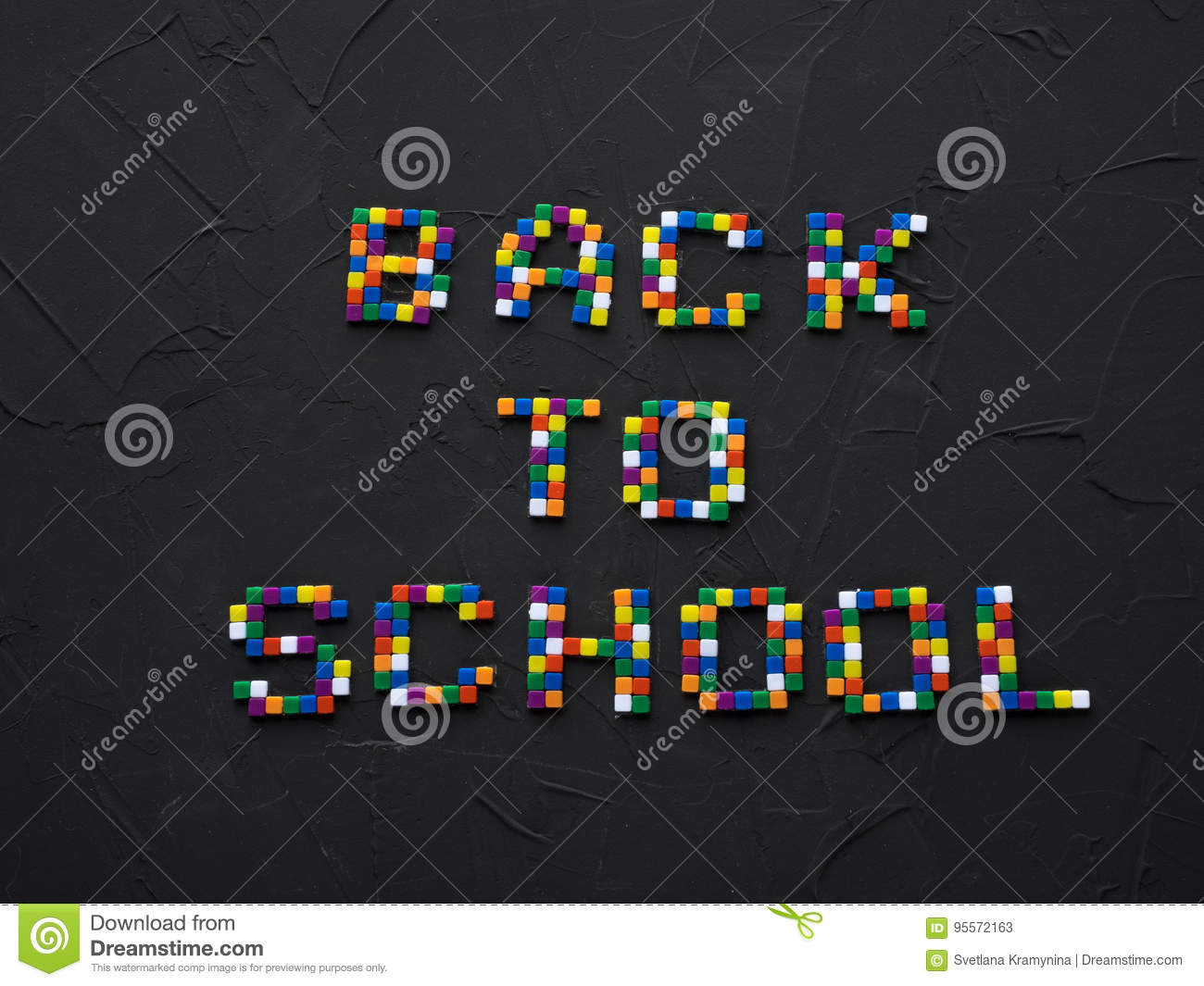 colorful back to school words with part of color pencil tips shown