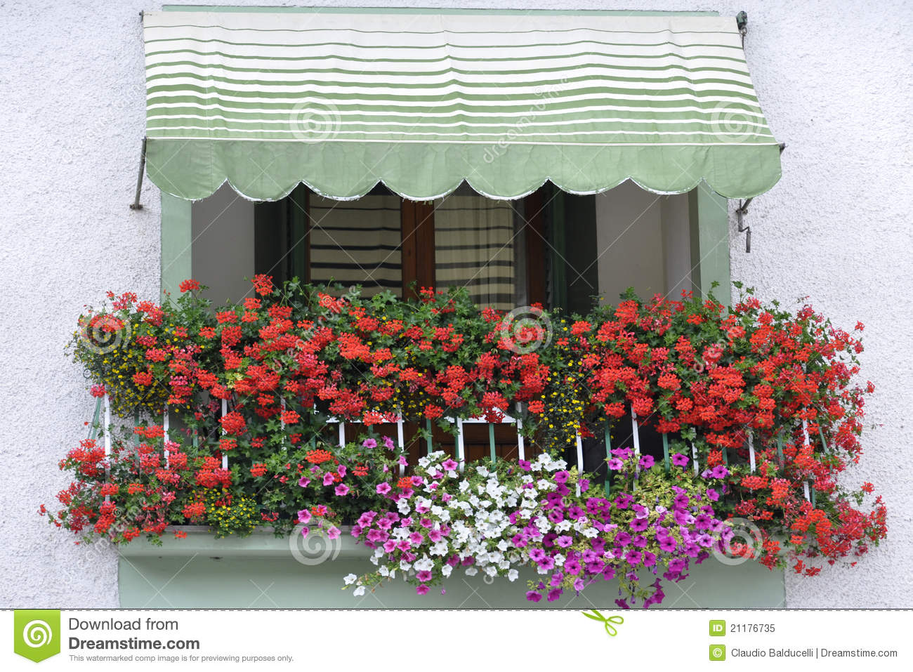 Colorful balcony with flowers in Italy
