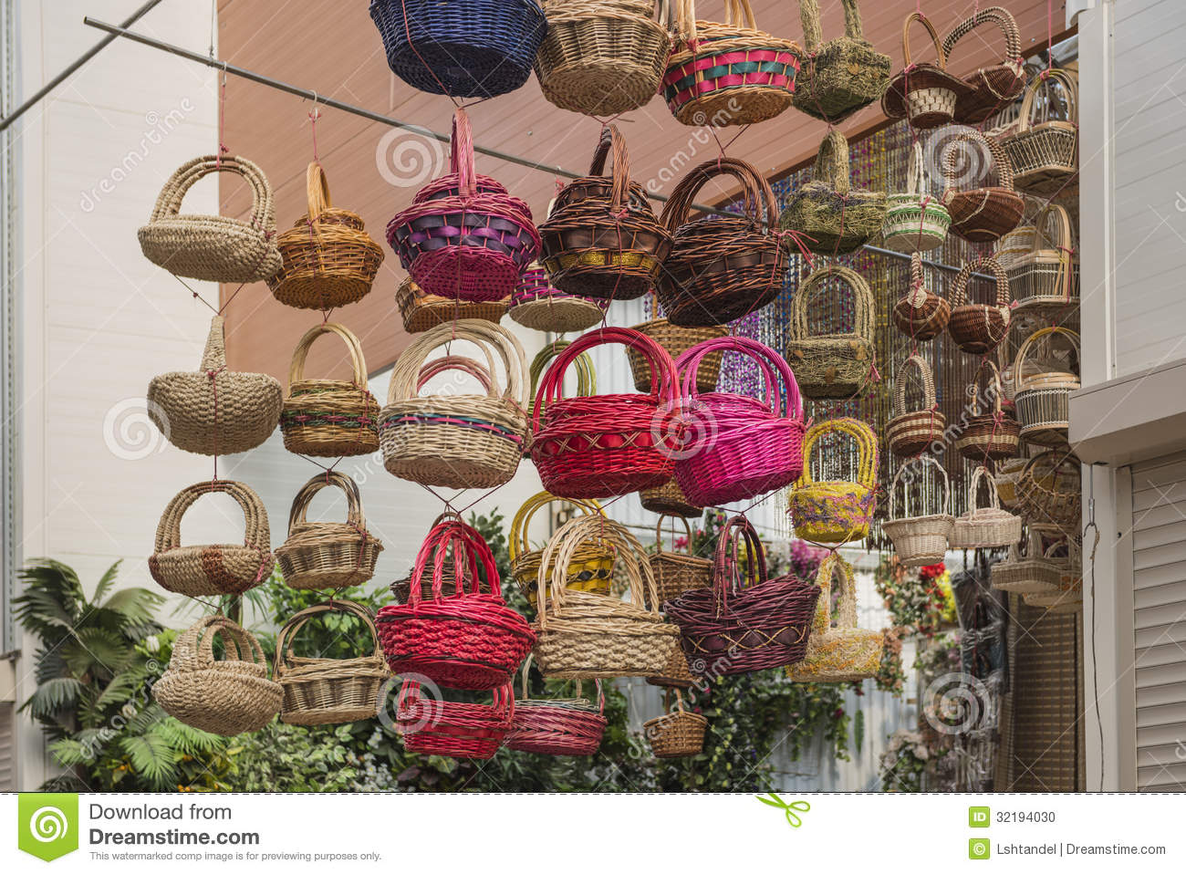 Colorful baskets at a flower shop hanging from the