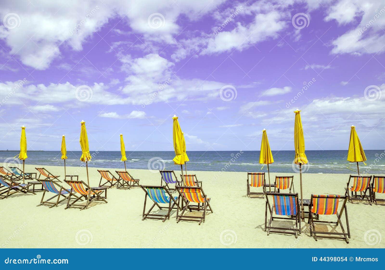Colorful Beach Chairs - Colorful beach chairs and closed sun umbrellas on beautiful beac
