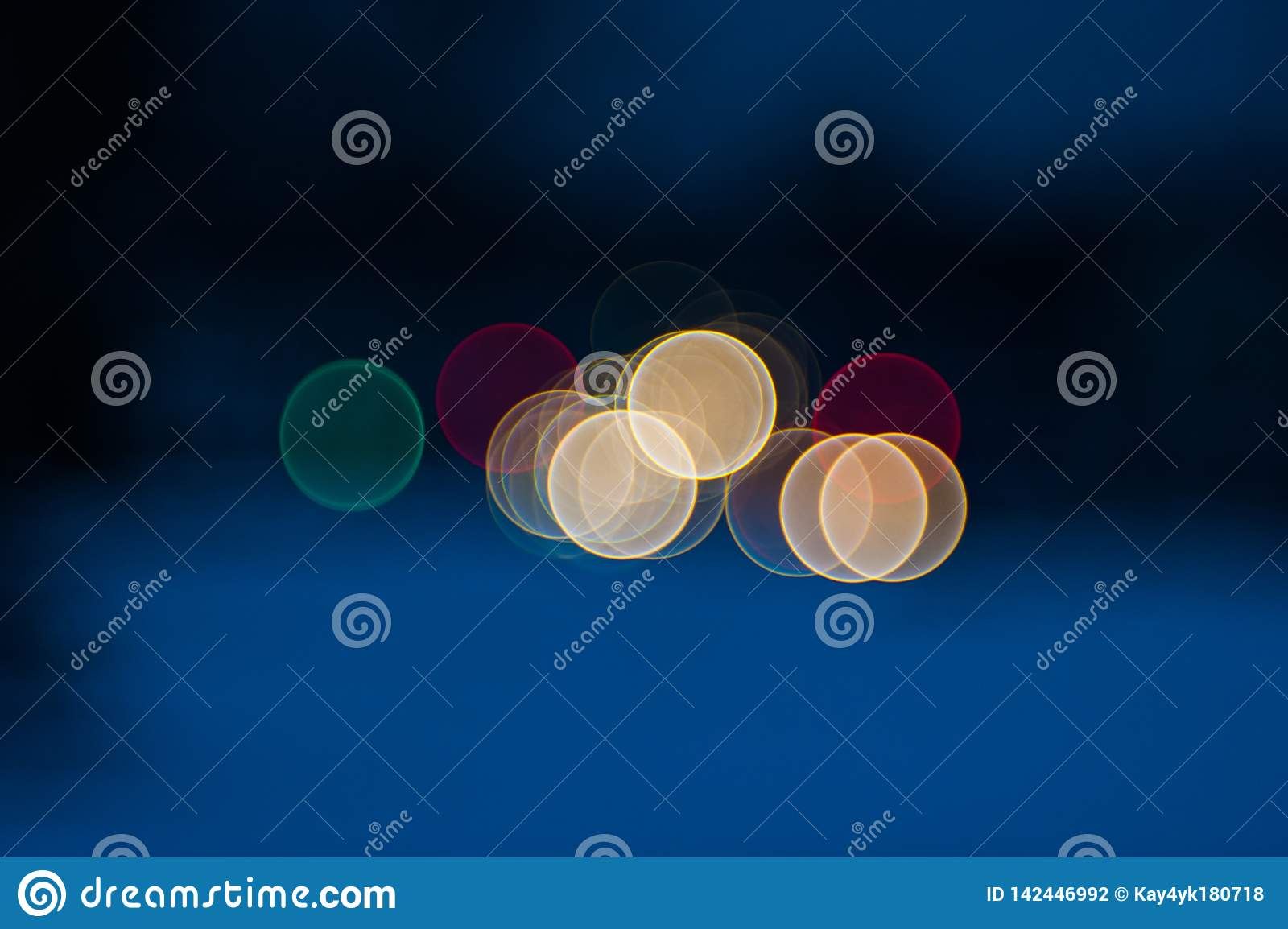 Colorful beautiful blurred bokeh background with copy space. Festive texture. Brilliant multicolored light spots on a dark blue