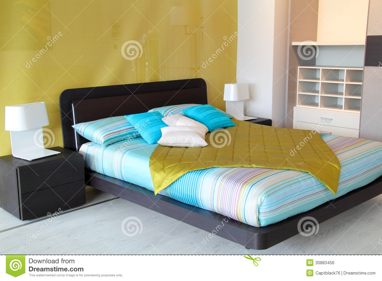 colorful bedroom with cyan and white pillow furniture store