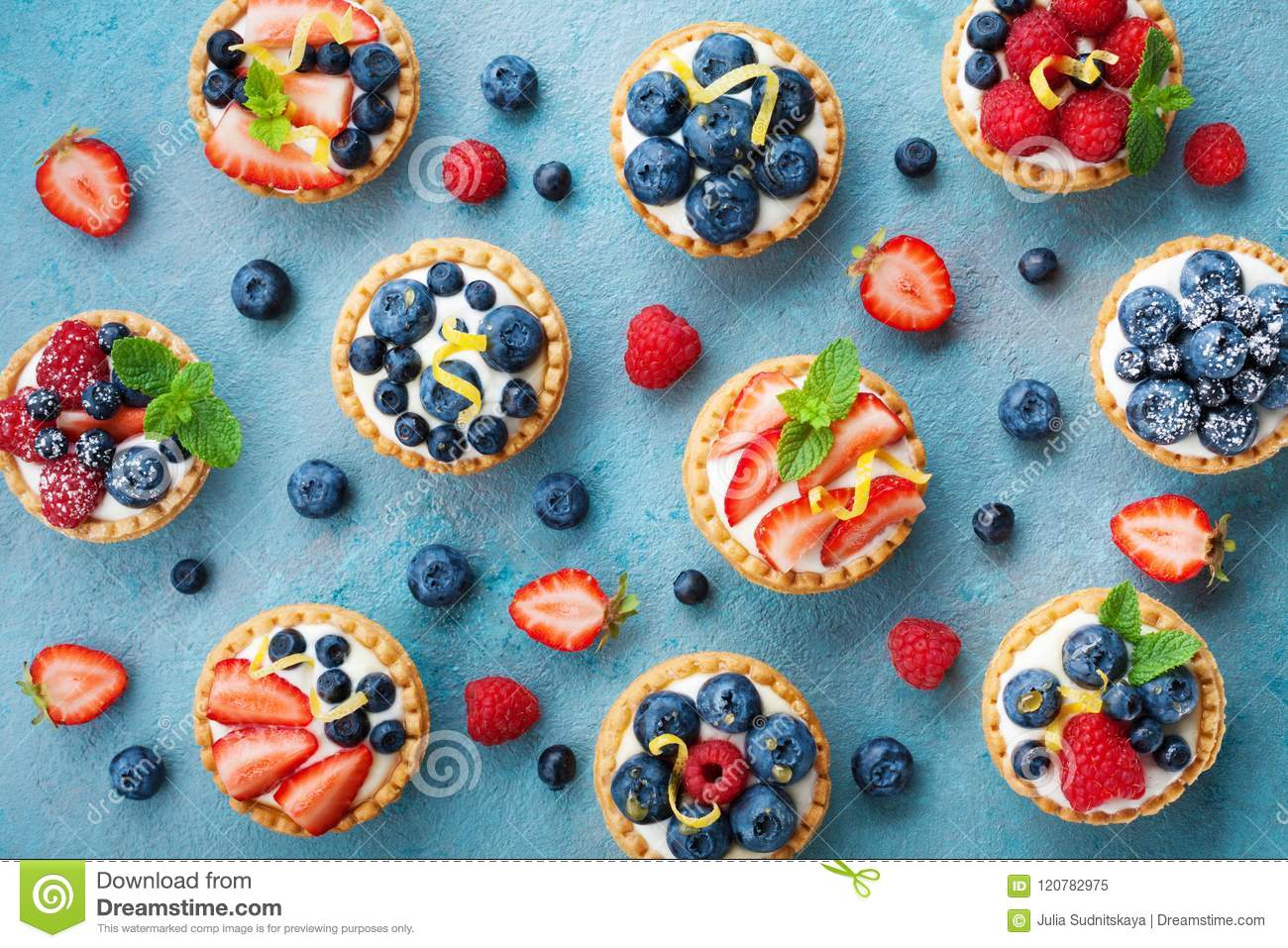 Colorful berry tartlets or cake for kitchen pattern pastry dessert from above