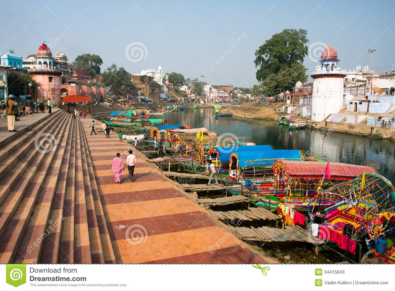 Colorful Boats Wait For The Passengers At The River Docks Of Indian City Editorial Stock Photo ...