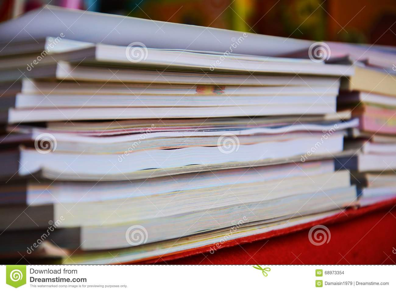 Colorful books on blurred background