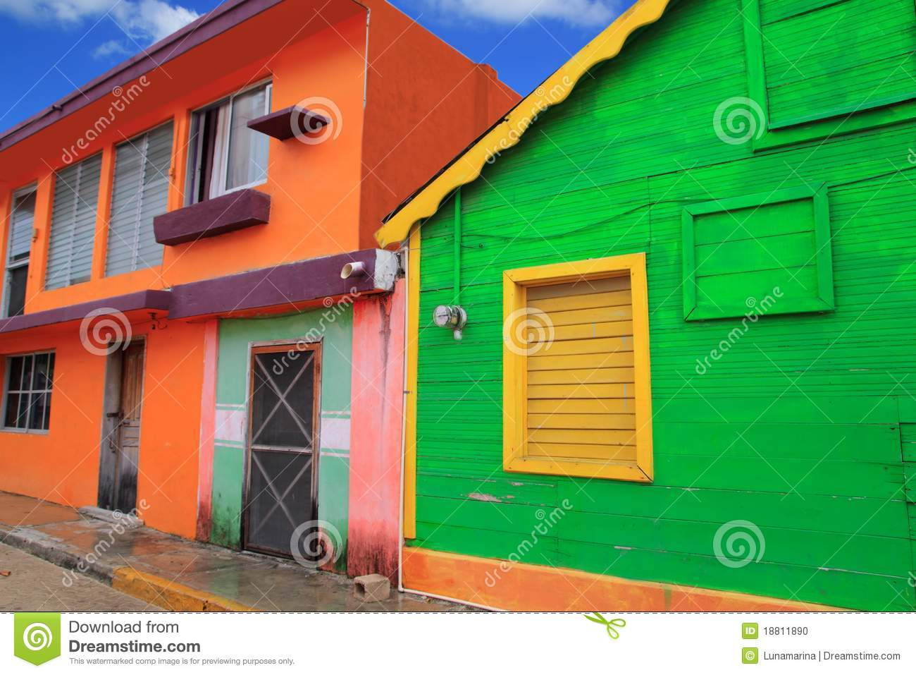 Colorful caribbean houses tropical isla mujeres stock for Tropical house color schemes