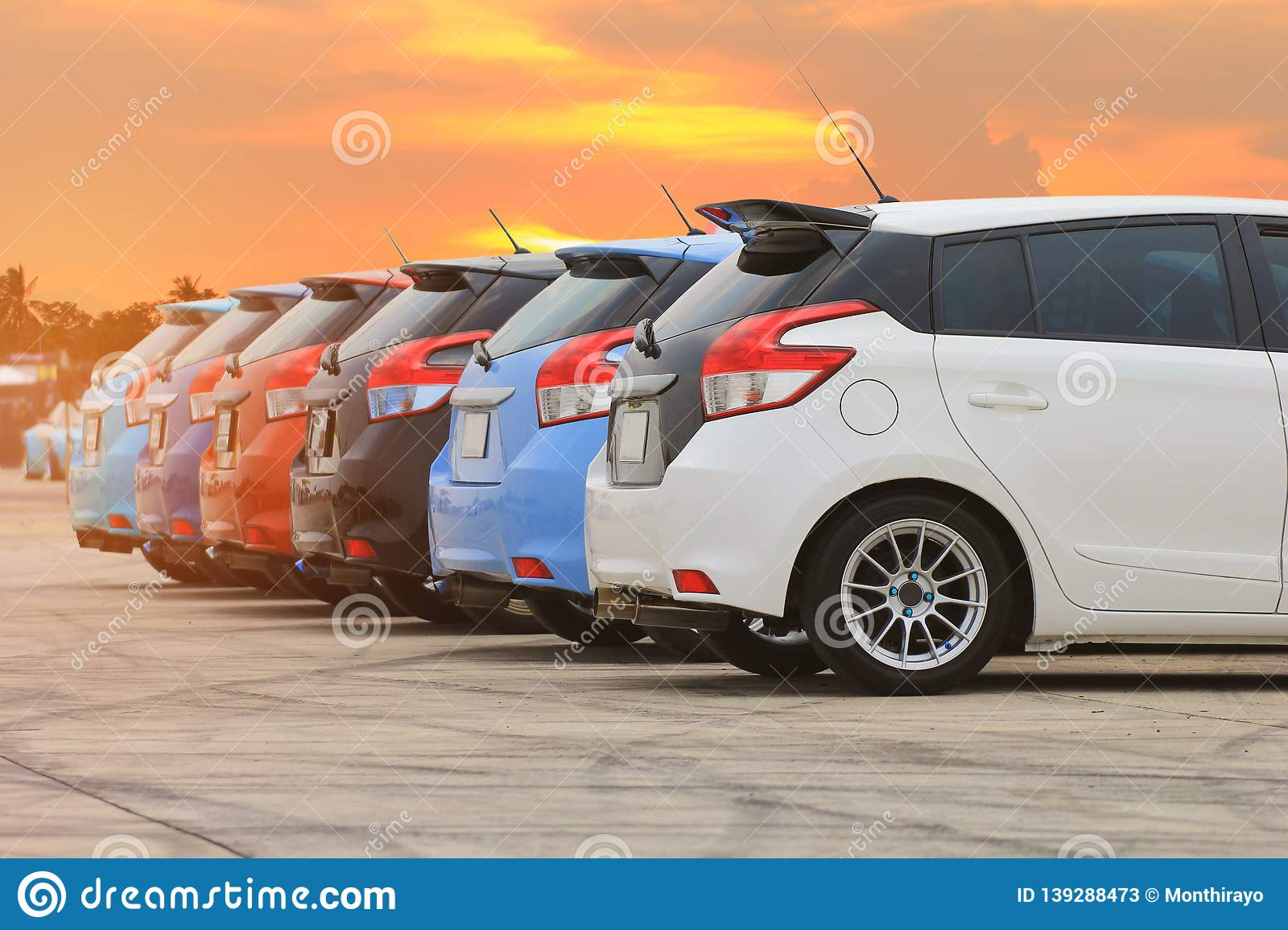 Colorful of cars in the parking lot on sunset background