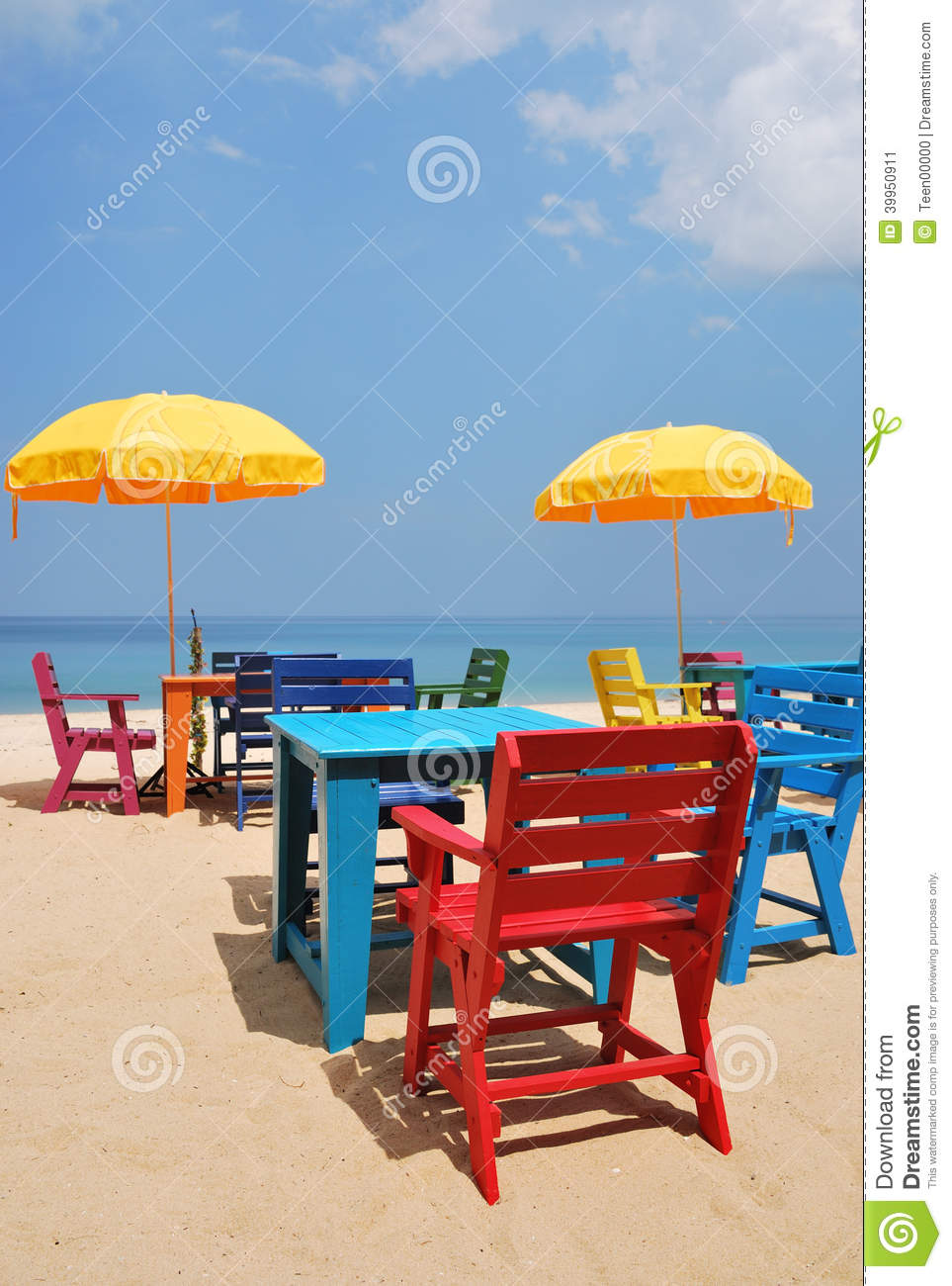 Colorful Chair And Table With Yellow Umbrella On The Beach