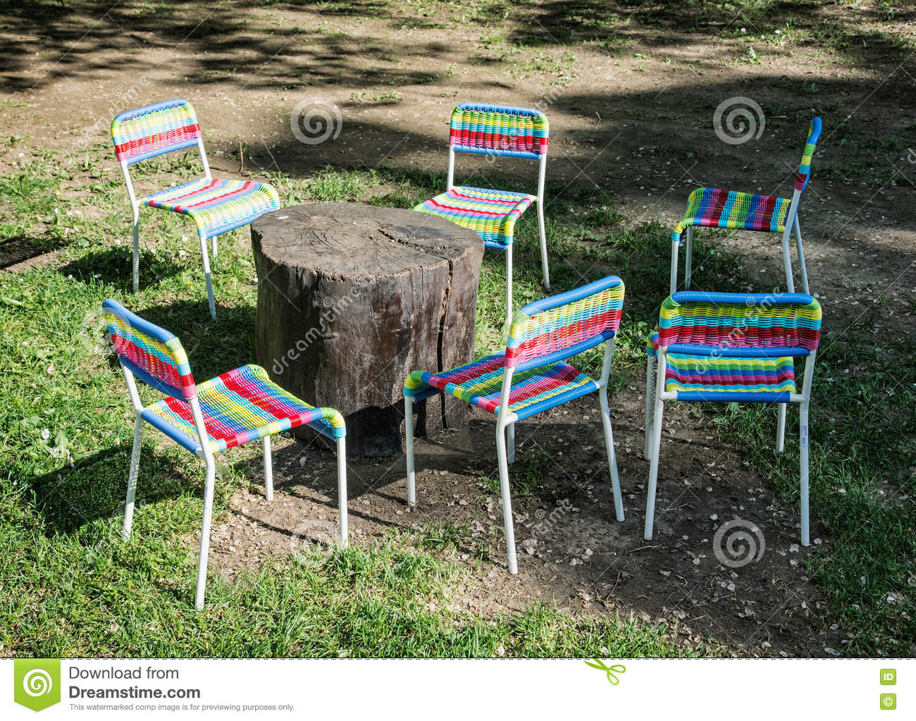Incredible Colorful Chairs And Wooden Table On The Lawn Stock Photo Interior Design Ideas Pimpapslepicentreinfo