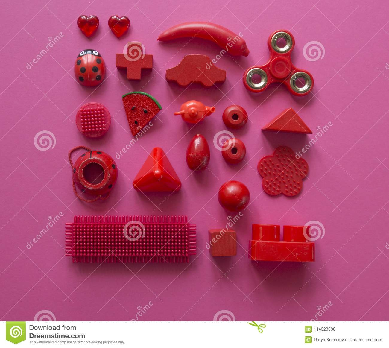 Colorful children`s toys on a bright background.