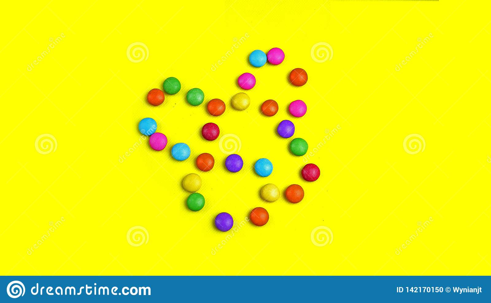 Colorful Chocolade Smarties On The Yellow Background   It Is