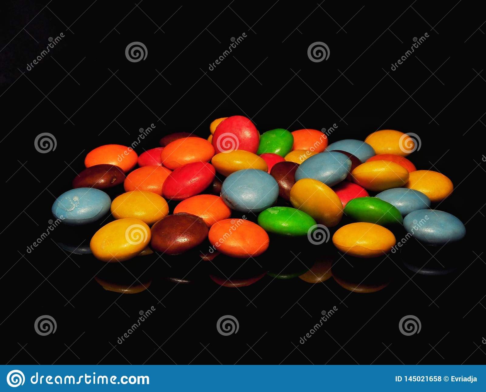 Colorful chocolate candy isolated on black background