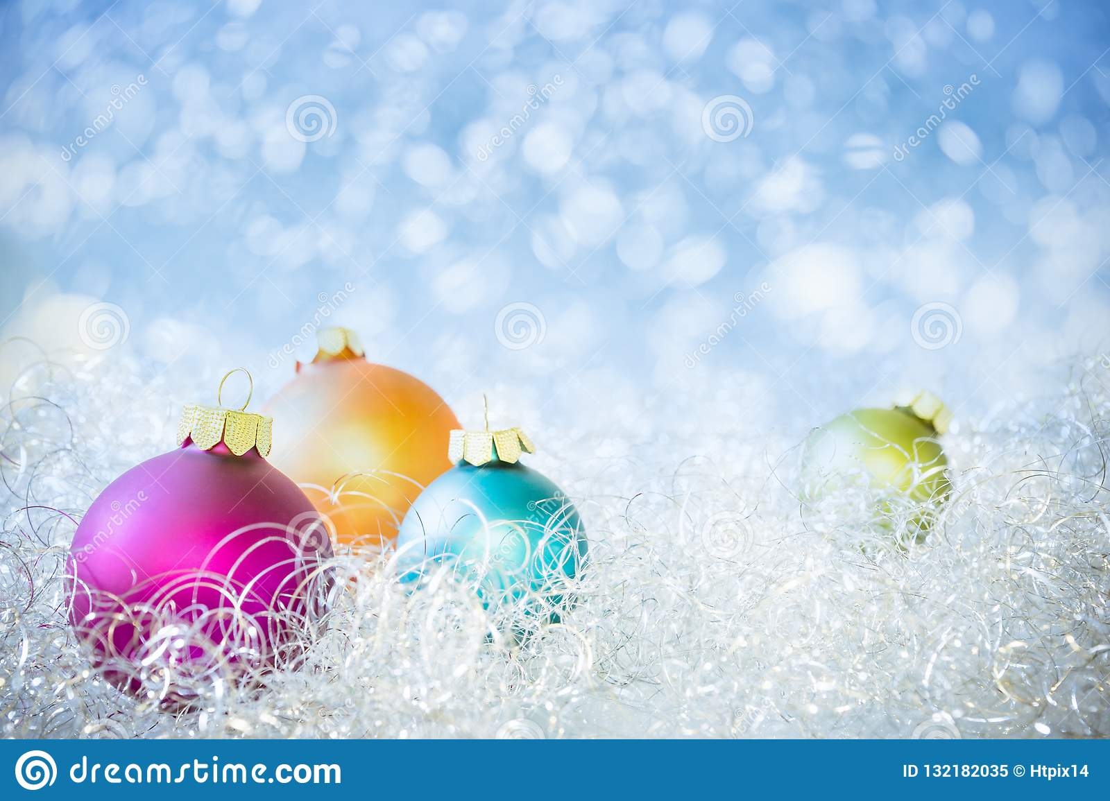 Colorful Christmas Balls with blue Bokeh Background