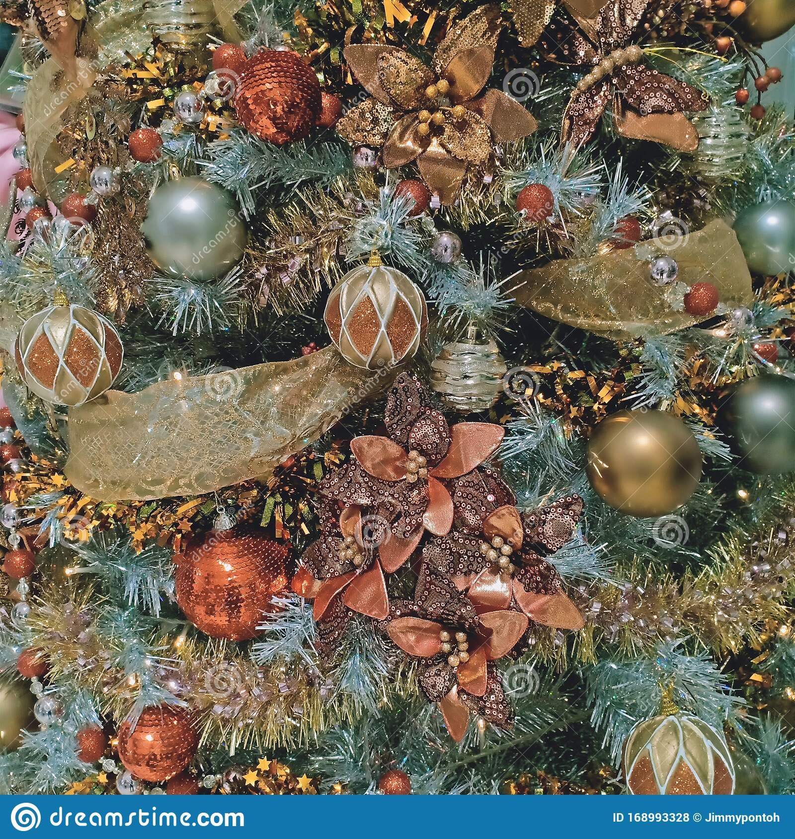 Colorful Christmas Decoration With Gold Ribbon Flowers And Balls Stock Photo Image Of Blue Holiday 168993328