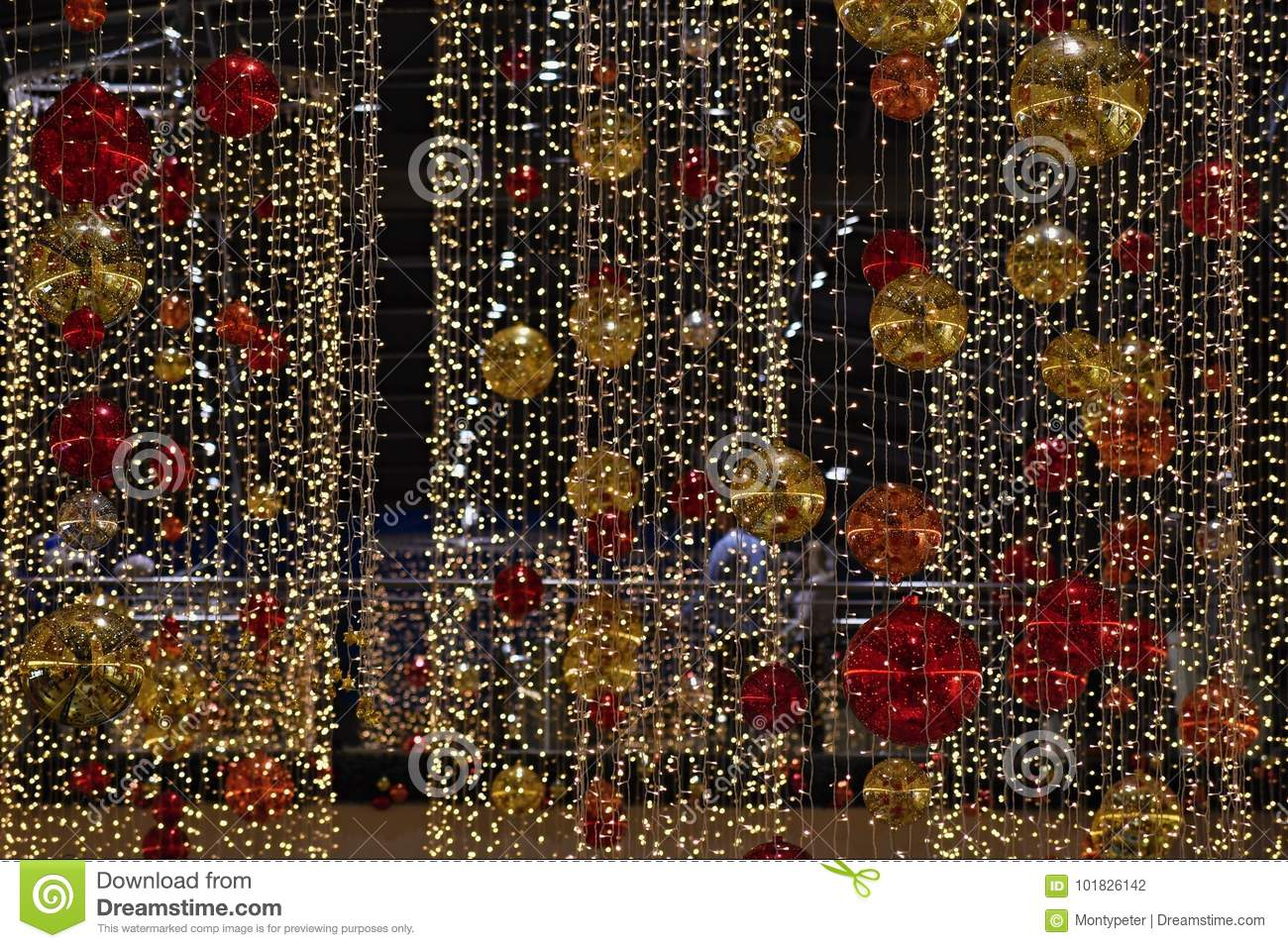 Colorful christmas Decoration. Winter holidays and traditional ornaments on a Christmas tree. Lighting chains - candles for season