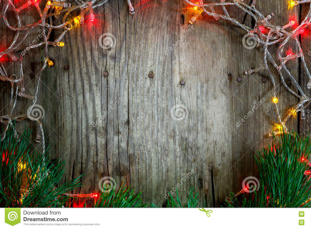 Colorful Christmas Garland Lights On Wooden Rustic Background