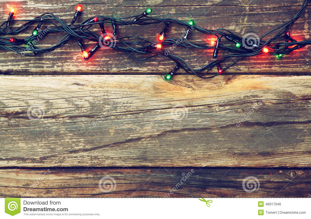 Colorful Christmas Lights On Wooden Rustic Background Retro Filtered Image