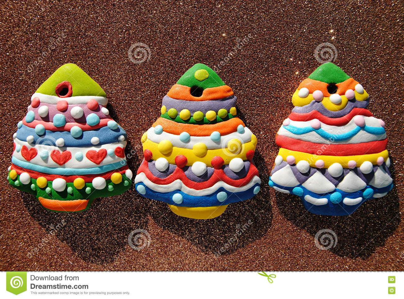 Colorful Christmas Background For Kids.Colorful Christmas Trees Cookies On A Brown Background