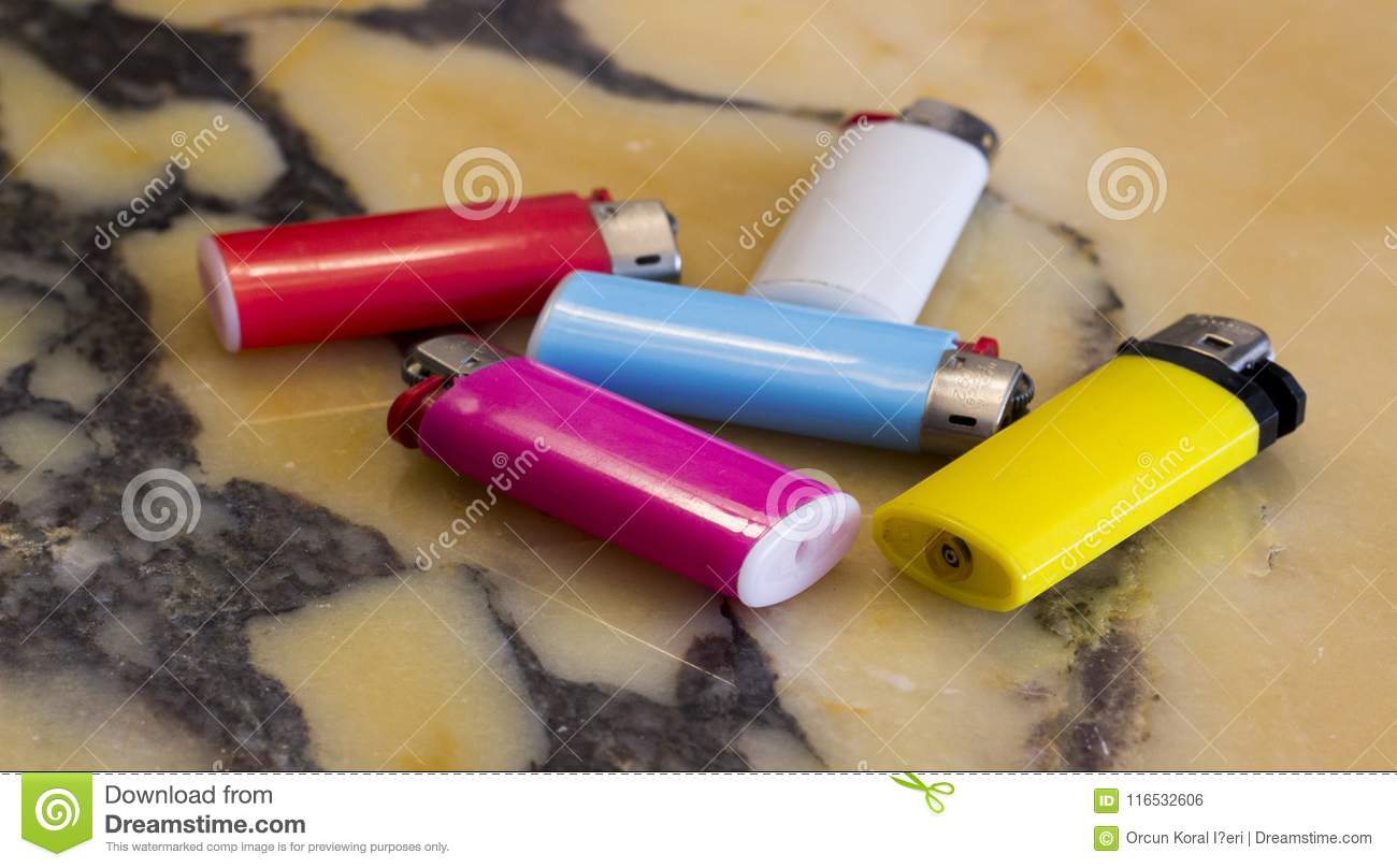 Colorful cigarette lighters on marbl