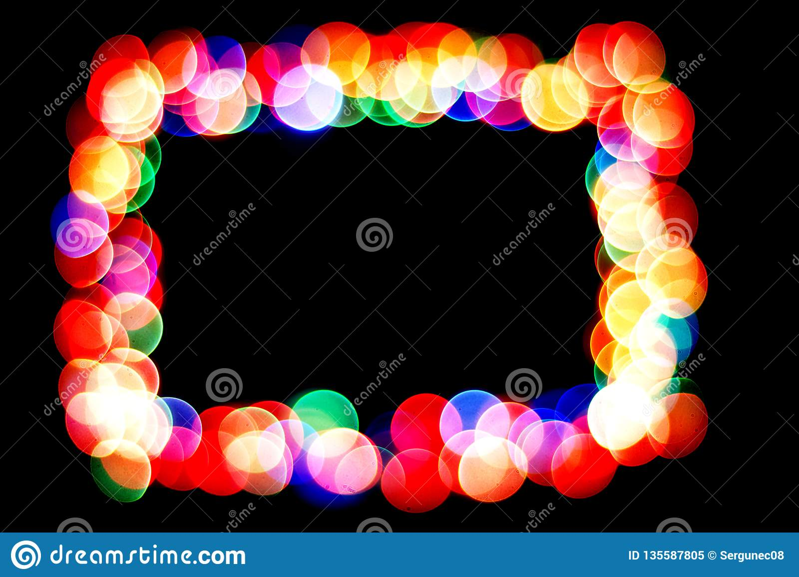 Colorful circles form a frame.bokeh circle isolated on black background.frame of circles