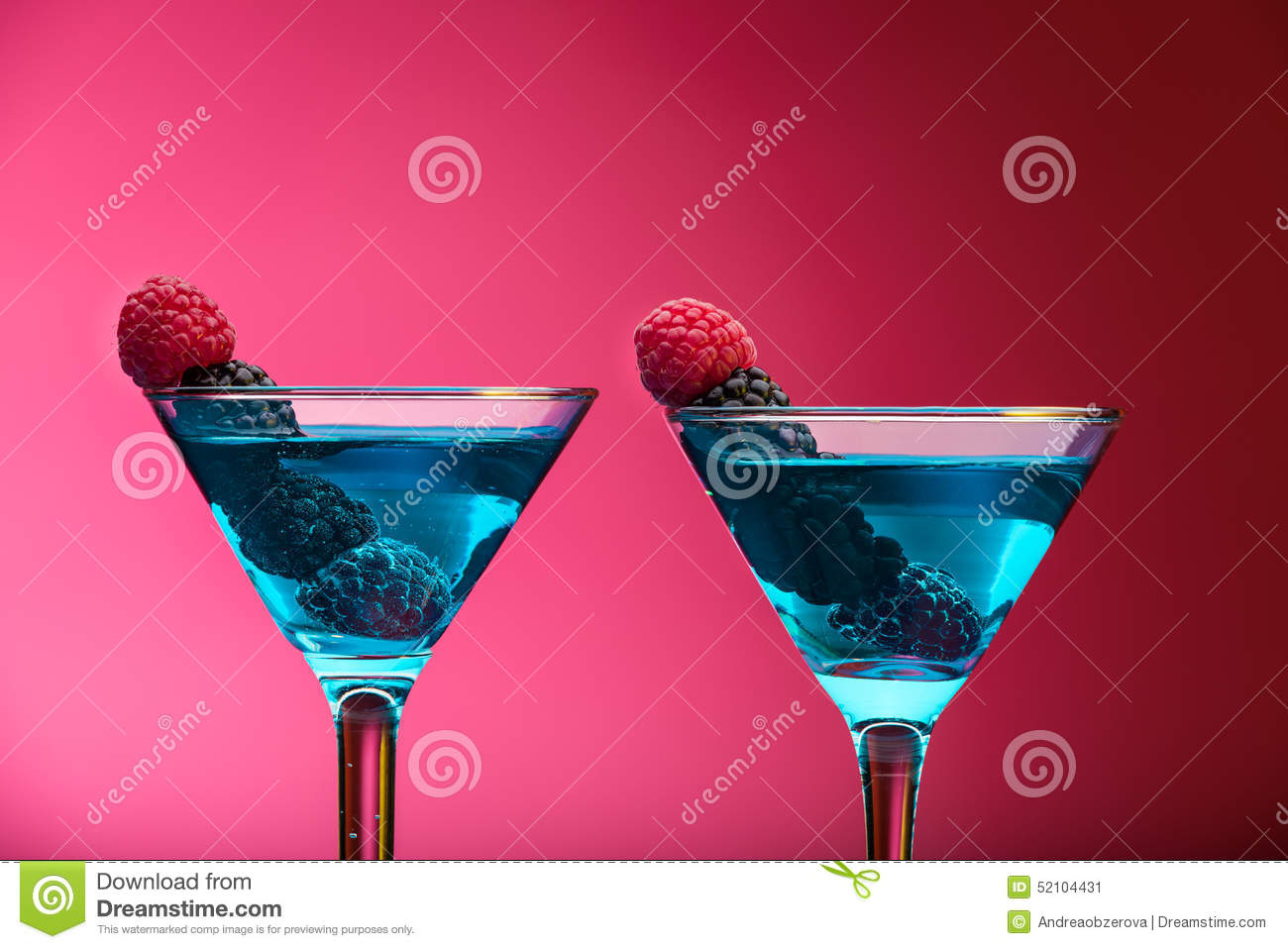Colorful cocktails garnished with berries, studio shot